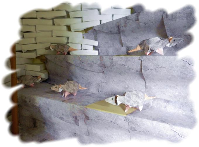 Origami rats in an alley