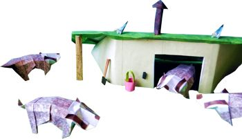 origami badgers around a selfmade paper house