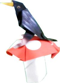 clipart of an origami bird dancing on a large mushroom