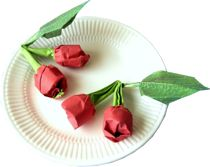 clipart of cute origami cherries on a small plate