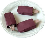 origami chocolate popsicles on a plate