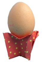 origami egg cup with polka dot pattern
