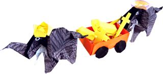 two origami elephants with a treasure of golden objects