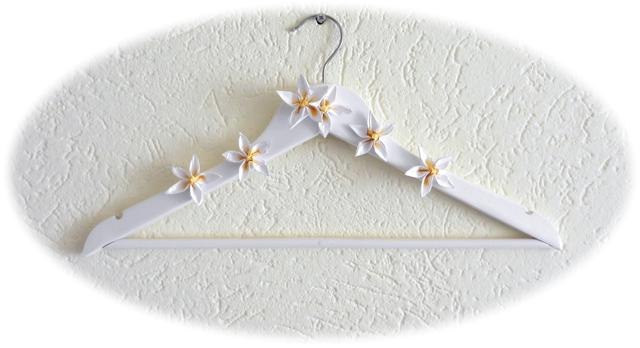 Clothes hanger with flower decorations