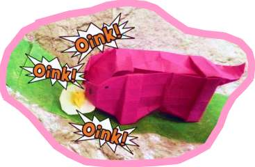 origami pig eating a fried egg