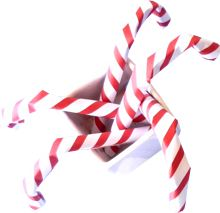 3d origami candy canes in a small white pot