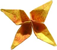 yellow origami flower with small red dots