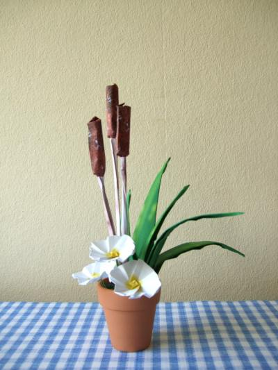 origami flower-arrangement with primroses and cattails