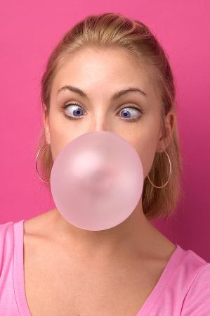 Girl blowing chewing gum