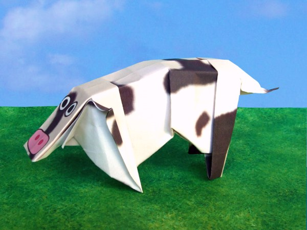 funny origami cow with tail and ears