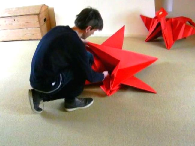 Folding a large Origami Dragon