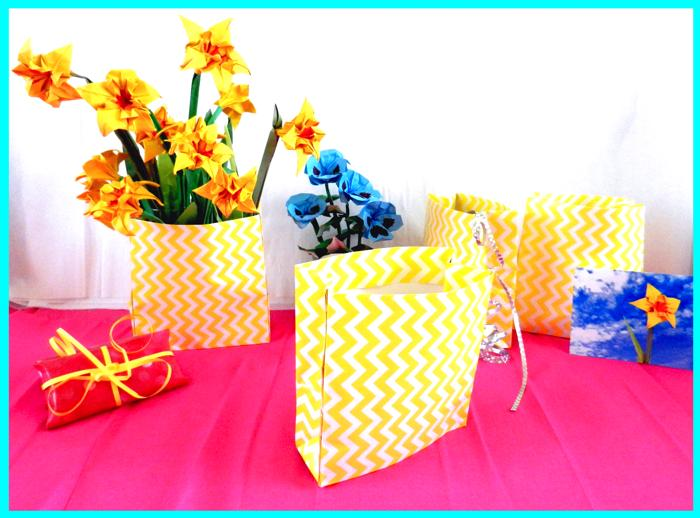 Origami narcissus flowers in a paper bag