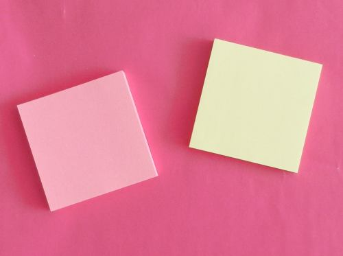 Pink and Light Yellow Sticky Note Papers