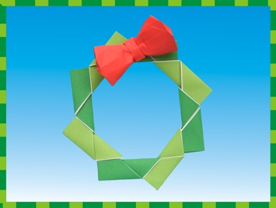 modern origami christmas wreath with a cute red bow