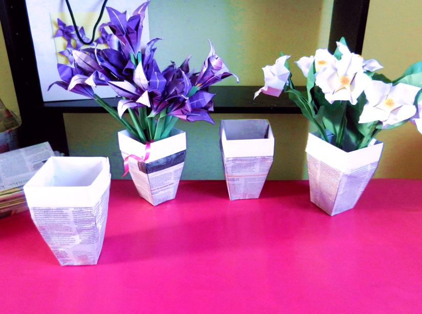 Origami flowers in newspaper pots