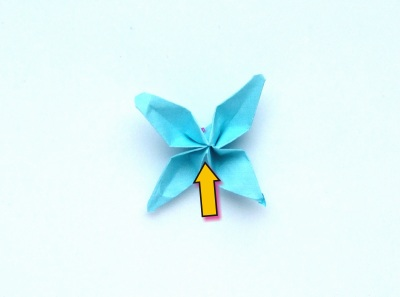cute little origami flower with 4 petals