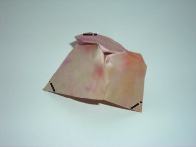 folding a pink origami flower