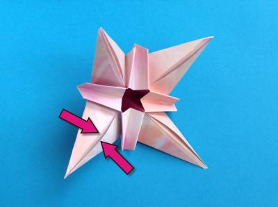 folding a beautiful pink origami flower