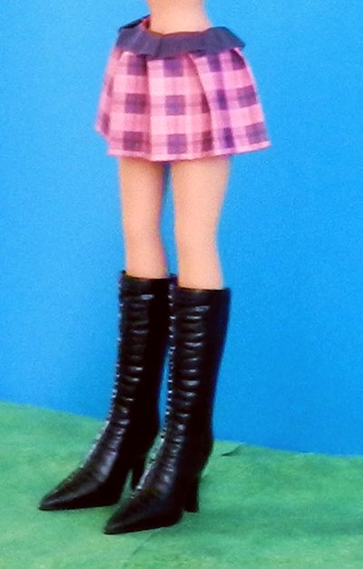 origami plaid skirt and black boots