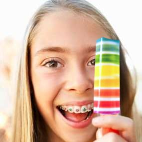 Girl with Fruity Rainbow Popsicle