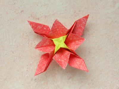 red origami flower with a yellow center