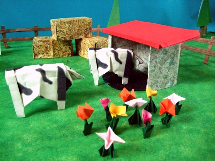 origami cows on the land of a farmer