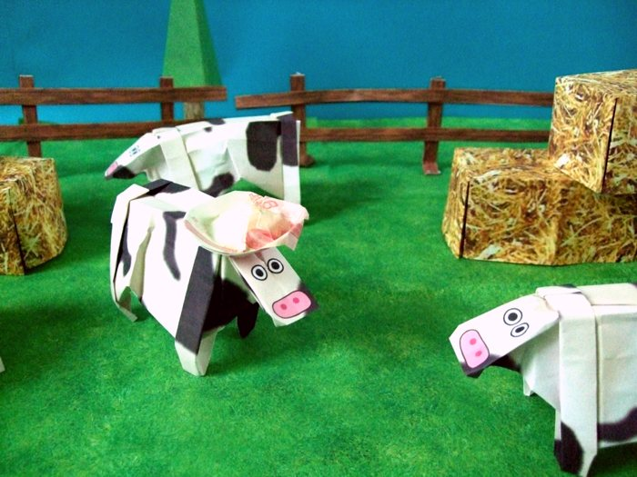 origami cow with a hat