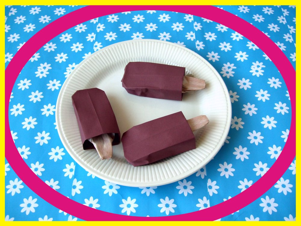 card with origami chocolate popsicles on a plate