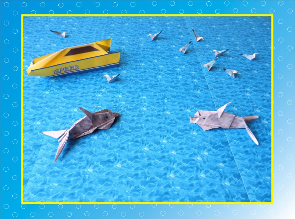 card with cute origami dolphins in the ocean