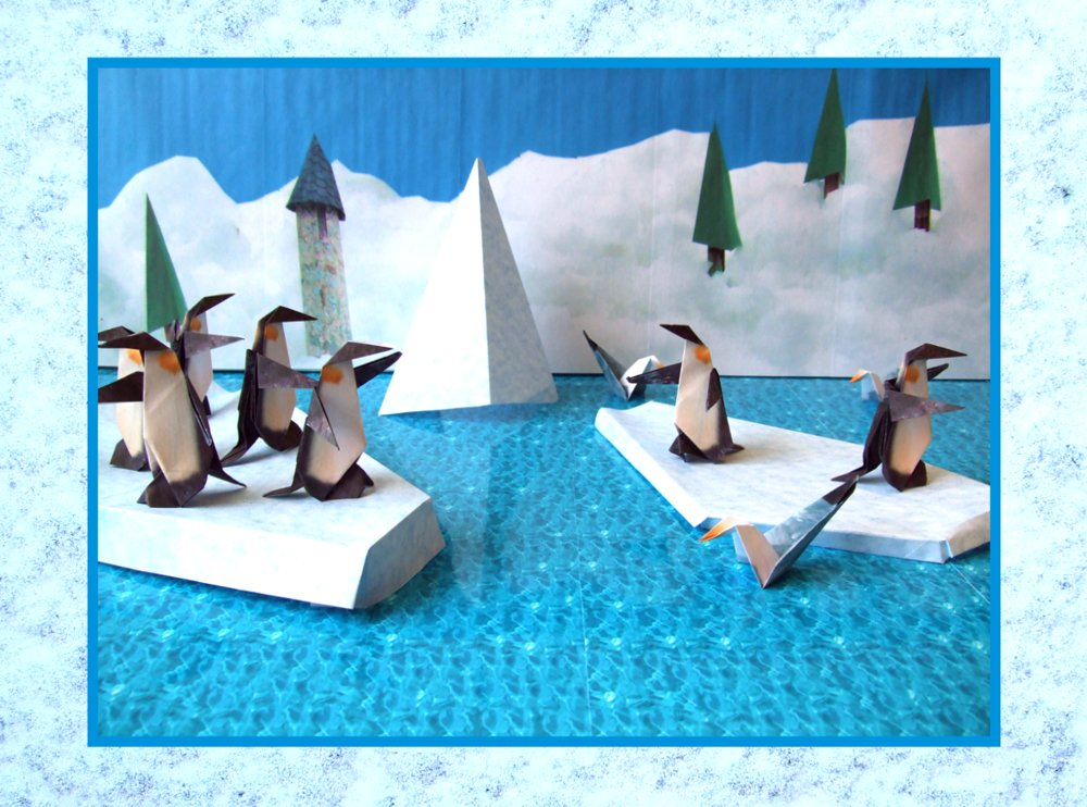 free card of origami penguins on the ice