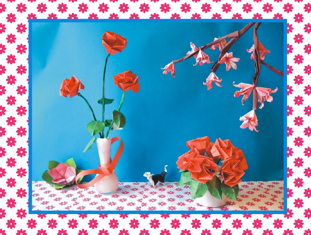 free card with red origami roses on a table
