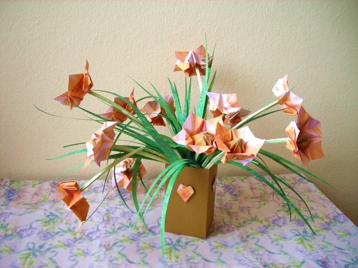 lovely orange coloured origami flowers in a paper pot