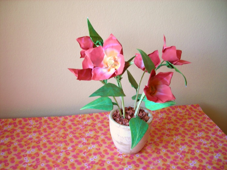 red origami flowers in a clay pot