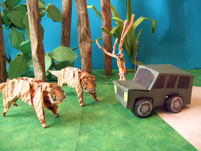 origami tigers in the jungle