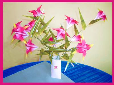 paper vase filled with bright pink origami flowers
