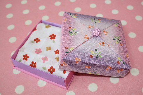origami box on a pink polka dot background
