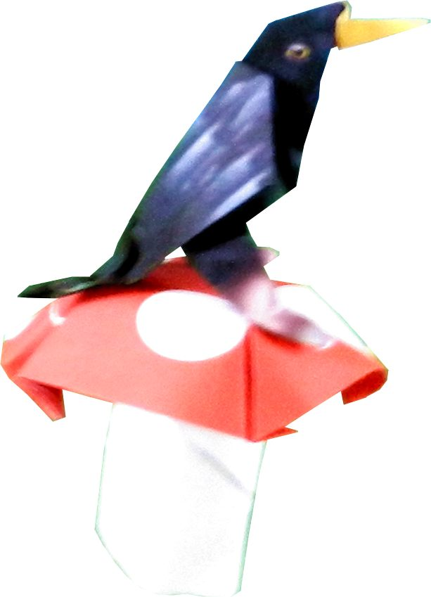 origami bird on a big red and white mushroom